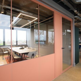 Project: Clockwise Wood Green   Shoreditch Edition Optima 117 Plus glass partitions with SG Edge Affinity door & Tech Panel